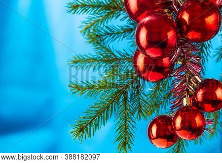 New Years Card With Red Balls And A Branch Of A Christmas Tree