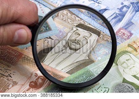 Jordanian Dinar In A Magnifying Glass A Business Background