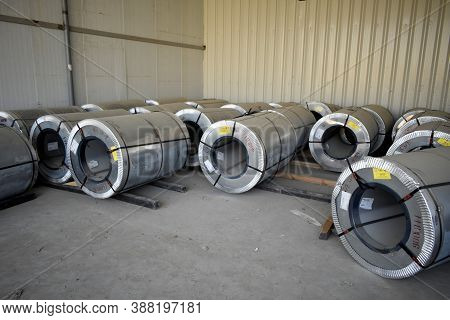 Rolls Of Steel Sheet Stored In Warehouse; Galvanized Steel Coil In The Duct Factory. Packed Rolls Of