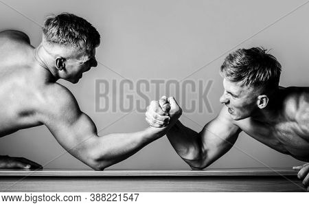 Arm Wrestling. Two Men Arm Wrestling. Rivalry, Closeup Of Male Arm Wrestling. Two Hands. Black And W