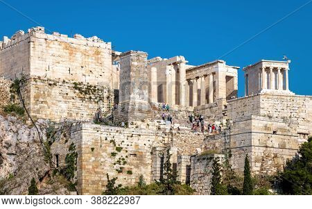 Acropolis Of Athens Close-up, View Of Ancient Propylaea, Greece. This Place Is Famous Tourist Attrac