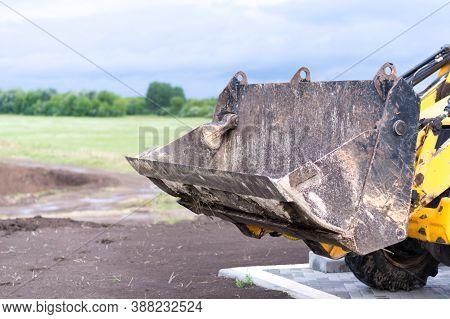 Excavator Bucket On A Summer Forest Background, Industrial Excavator Machine, Focus On Excavator Buc