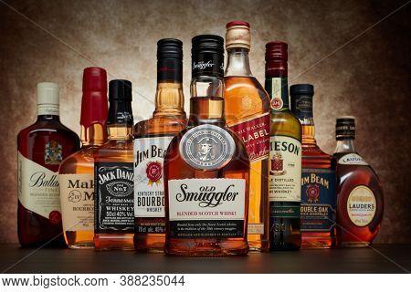 St.Petersburg, Russia - April  2020 - Bottle of Old Smuggler blended scotch whisky on background of other popular brands of whiskey (whisky) on dark  background