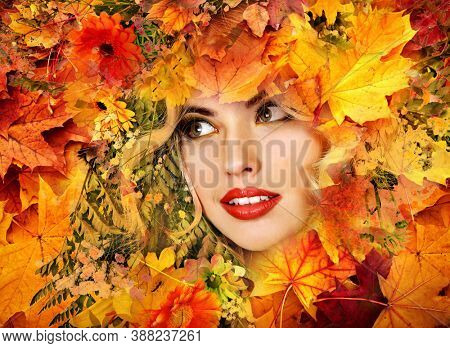 Autumn leaves background with beauty face of beautiful woman close. Fashion dream in red fall color outside.