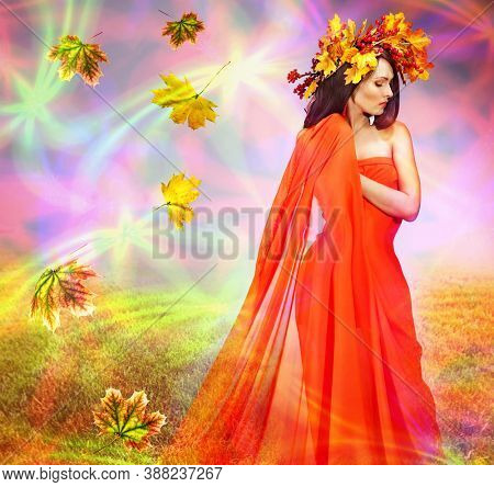 Autumn leaves background with woman. Conceptual fall fashion dream in red fall color of september sun.