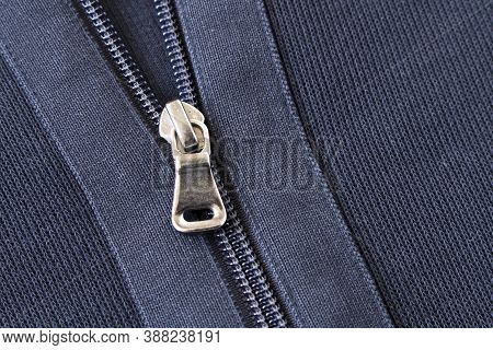 Zipper On The Blue Jacket. Close Up. Selective Focus