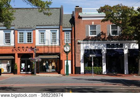 NEW CANAAN, CT, USA - OCTOBER 4, 2020: Downtown in nice day with store fronts  Ann Taylor and Ralph Lauren on Elm Street