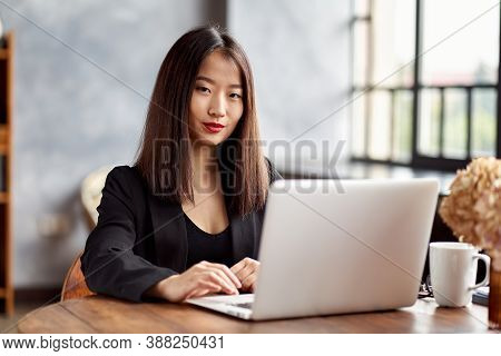 Asian Business Woman Working In Laptop In Office. Japanese Businesswoman