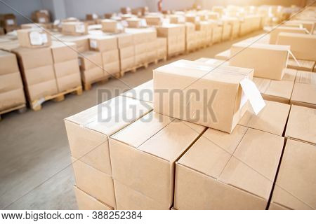 Cardboard Boxes In Storage At The Production Warehouse. Warehouse Concept For Groceries And Food Pro
