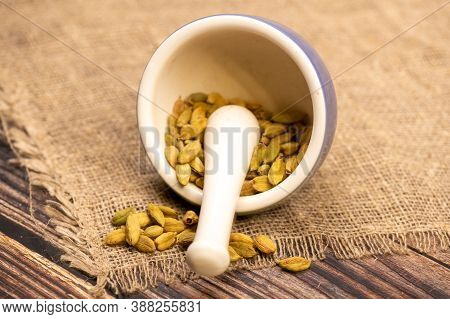 Cardamom In A Ceramic Mortar And Pestle, Close-up, Selective Focus.