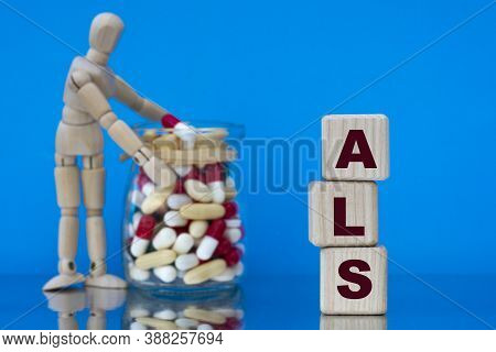 Als (amyotrophic Lateral Sclerosis) - Word On A Wooden Block On A Blue Background With Pills And A W