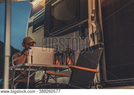 Caucasian Men In His 40s Doing His Online Marketing Job Next To Camper Van As Remote Work. Self Empl