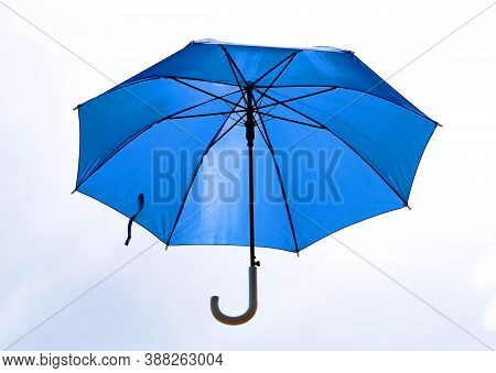 A Blue Umbrella That Was Unfolded Isolated On White Background.