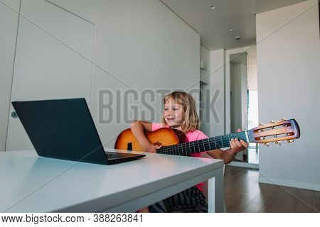 Cute Girl Having Guitar Lesson Online At Home