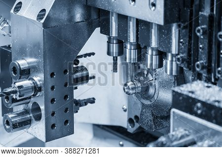 The Operation Of Multi-tasking Cnc Lathe Machine Swiss Type Making The Pipe Connector Parts. The Hi-