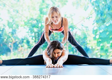 Young Active Women With Slim Body Doing Stretching Exercise Side Split With Body Bend To Keep Fit, B
