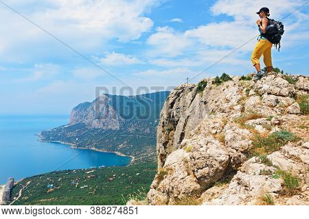 Young Active Woman Stand On Mount Top. Look At Amazing Sea Landscape. Family Travel Adventure, Hikin