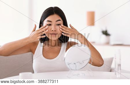 Facelift, Anti Aging Treatment, Beauty Secrets Concept. Portrait Of Young Asian Woman Massaging Her