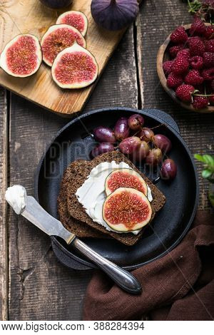 Tasty Tapas, Snack Or Crostini Or Bruschetta With Toasted Bread, Cheese, Figs. Delicious Breakfast,