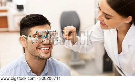 Eyesight Test, Medical Examination Concept. Portrait Of Smiling Specialist Female Optometrist Checki
