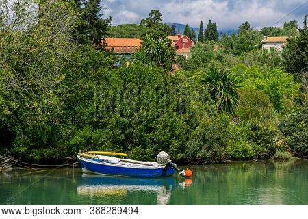 Beautiful Tranquil Landscape - Sea Bay With Calm Water, Fisher Boat, Coastline - Green Lawns And Pal