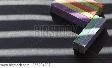On A Dark Background, Bright, Colored Crayons.light Pattern On The Composition Of Crayons.\nlight An