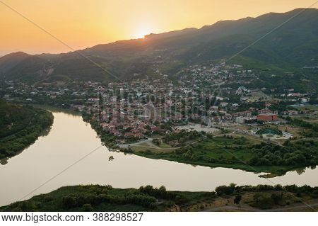 Aerial View Of The Small Town And View Of The Merger Of Two Rivers At Sunset