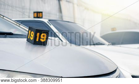 Service Number On Top Of Customer's Vehicles At An Auto Repair Service Center