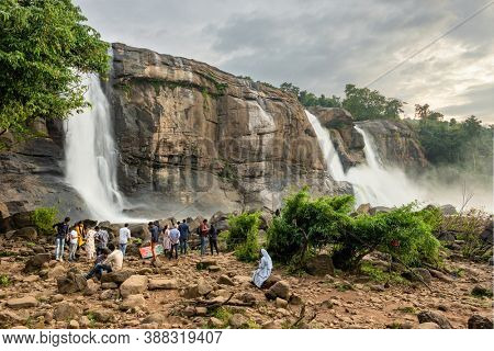 November 30, 2019: Unidentified Indian tourists visiting Athirappilly waterfalls in Kerala, India