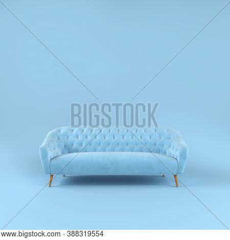 Stylish Blue Fabric Sofa With Wooden Legs On Blue Background With Shadow. Fashionable Comfortable Si