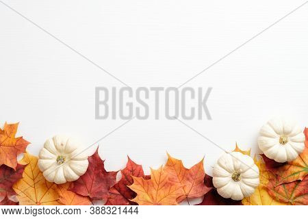 Autumn Composition. Frame Made Of Fallen Leaves And Pumpkins On White Background. Flat Lay, Top View