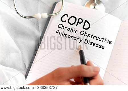 Doctor Holding A Card With Text Copd Chronic Obstructive Pulmonary Disease, Medical Concept