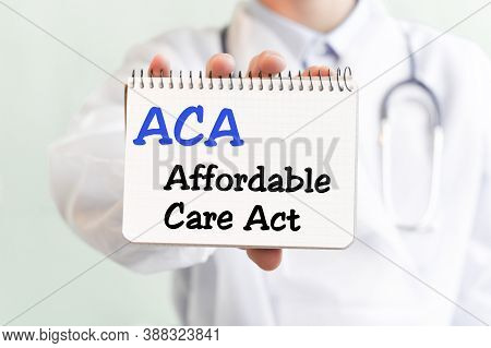 Doctor Writing Word Aca Affordable Care Act With Marker, Medical Concept