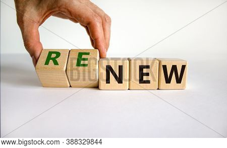 Time To Renew. The Words 'new' And 'renew' On Wooden Cubes. Male Hand.  Beautiful White Background,