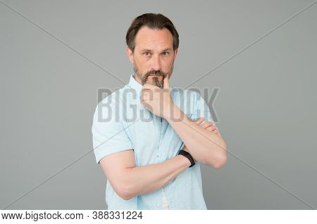 Serious And Thoughtful. Serious Look Of Mature Man. Bearded Man Think Grey Background. Focus Thinkin