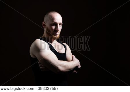 Serious Concentrated Male Model. Handsome Confident Man. Serious Guy Posing In Studio
