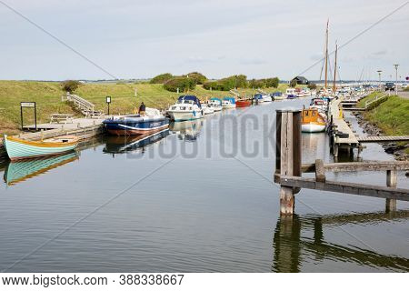 Løgstør, Denmark - September 3, 2020: Variety of boats moored in the defunct Frederik VII's canal next to the Limfjord inlet