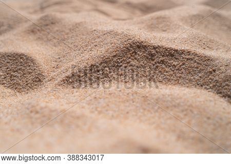 Brown Sand Texture Background From Fine Sand With Natural Line Wave On It.