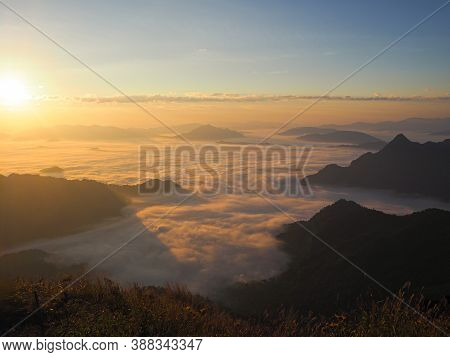 Morning Mist At Phu Chee Fah In Chiang Rai Province, Thailand. Famous Tourist Attractions. Holiday C