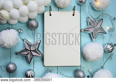 Christmas And New Year Mockup.winter To-do List.empty Notebook, Silver Decorative Ornaments And Whit