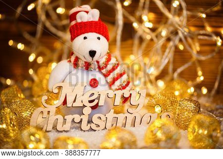 Toy Snowman At Christmas Garlands And Text Merry Christmas