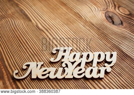 Happy New Year Text. Decorative Wooden Toy