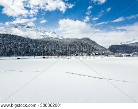 Snow Field With Forest And Railway Line At The Background In Winter