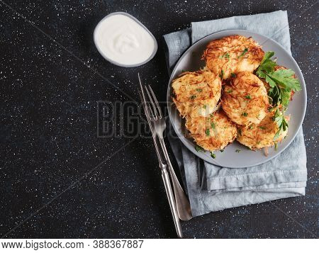 Close Up View Of Potato Pancakes. Potato Flapjack On Gray Plate Over Dark Blue Background, With Fres