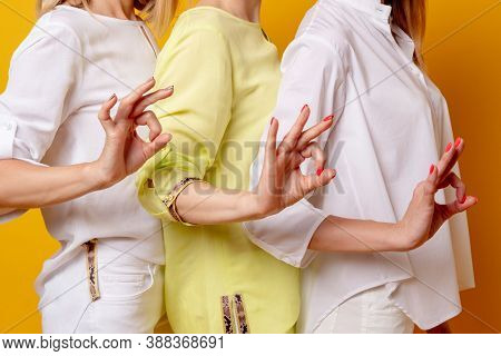 Female Approval. Ok Sign. Acceptance Solidarity. Perfect Choice. Three Women In White Yellow Blouse