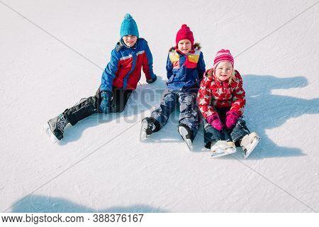 Happy Kids Skating In Winter Nature, Family Winter Sport