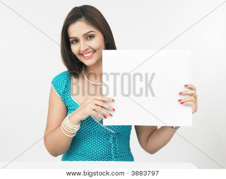 Beautiful Young Woman With A Blank Placard