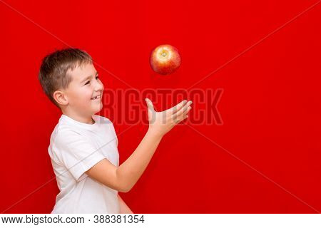 Side View Close Up European Boy Kid Child Schoolboy Throw Up Apple Prtrait Of A Happy Beautiful Chil