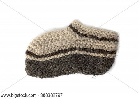 Warm Knitted Socks From Sheepskin Wool Isolated On White Background. Large Knitting, Handmade, Tied