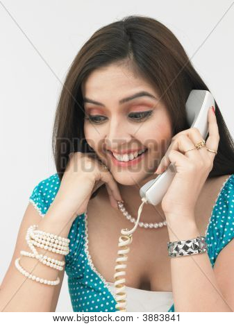 Asian Female Talking In The Phone